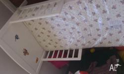 White toddler bed with standard cot size mattress still