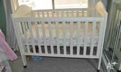 White wooden cot only (no mattress) in good condition.