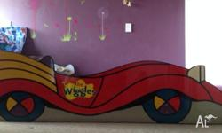 Selling WIGGLES RED CAR kids bed in great condition. No