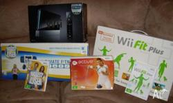Wii console Nunchuck remote Wii fit and board Biggest