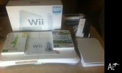 - White Wii Console - Excellent condition, hardly been