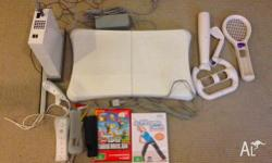 wii with wii fit board and Mario games good condition