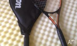 Two tennis racquets, purchased as apartment has tennis