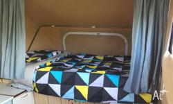 Windup campervan,2 doubles and table converts to bed,