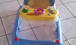 Winnie the Poo musical baby walker with feed tray. Able