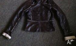 I am selling a women's size 8, leather type woolly