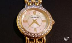 Timeless pearl face gold watch. Very classy. Pick up