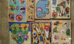 These are all wooden puzzles and some have a picture