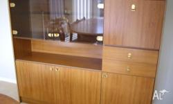 Wood wall unit with glass doors, cupboards and 2