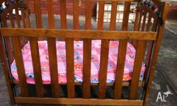 up for sale is baby cot including mattress in good