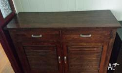 Dark wooden cabinet with draws. 100% wood. Measures 1.2