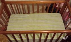 This new mahogany wooden cot is for sale with an