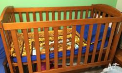 Selling my cot it comes with the change table that sits