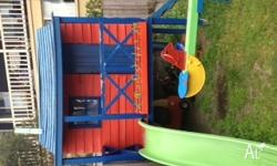 Lovely wooden cubby house with hours of fun left in it.