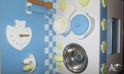 blue and white coloured wooden play kitchen including