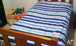 Solid timber single bed with kids mattress. Some very