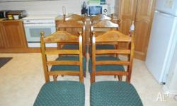 This set of wooden table and chairs V.G.C are to big