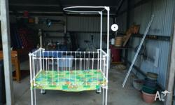 Newly powder coated wrought iron baby's cot in very