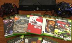 Selling as pictured an Xbox Comes with 8 games and 2