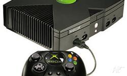 XBox for sale with two remotes (one wireless - includes