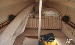 Heaps of sails, near new large headsail, 8 hp outboard,