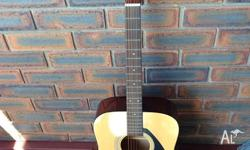Barely used Yamaha acoustic guitar. Pristine condition.