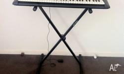 Almost new Yamaha Keyboard with 61 keys, along with the