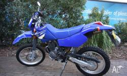 Very Good Condition; low kilometres, 4 Stroke. Spare