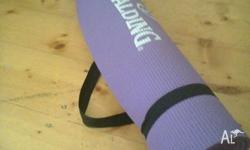 Second-hand purple Spalding yoga mat in good condition.